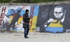 A man looks at a graffiti produced to support the territorial integrity of Ukraine and to protest Russia's annexation of Crimea in Odessa